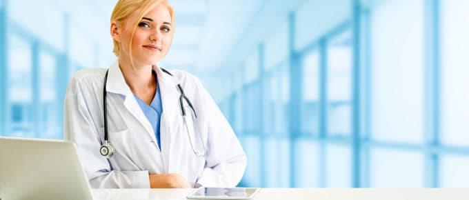 female-doctor-smiling-with-laptop
