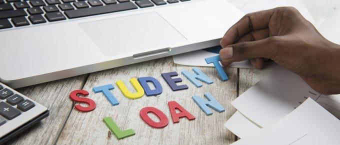 hand-arranges-letters-student-loans