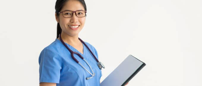 young-female-nurse-smiling-clipboard