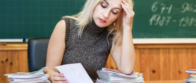 young-female-teacher-stressed-over-work