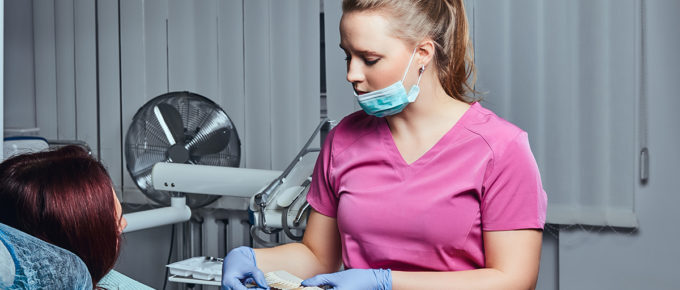 female-dentist-working-patient