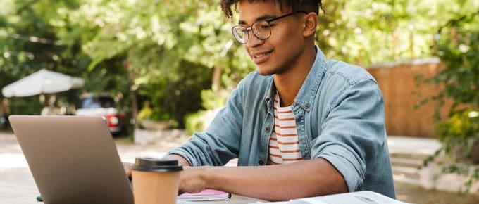 young-man-studying-laptop-park