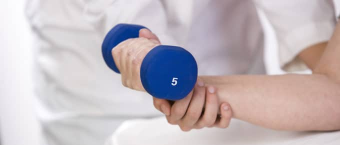physical-therapist-helping-patient-five-pound-weight