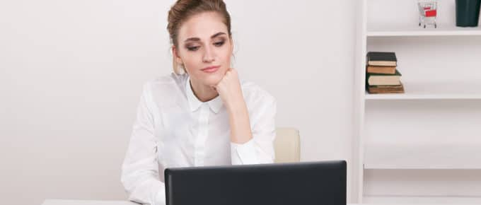 young-female-lawyer-considering-laptop