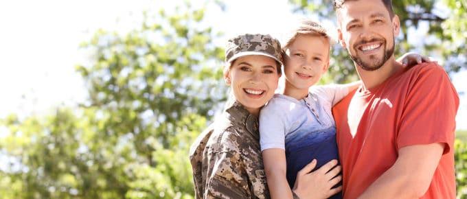 military-family-female-service-member-husband-son-smiling-park
