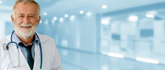 senior-male-doctor-hospital-background