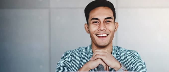 young-business-man-smiling-laptop